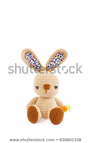 Funny knitted rabbit toy isolated on white background  Stock photo © teerawit