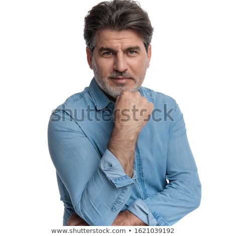 smiling senior casual man holding his chin and smiles Stock photo © feedough