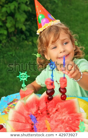 little girl in cap eats fruit in garden, happy birthday Stock photo © Paha_L