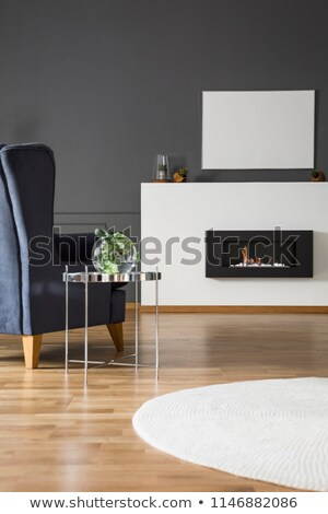 Comfy Armchair In Front Of A Fireplace Stock Photo