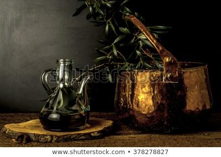 olive oil jar and cooper pot still life stock photo © marimorena