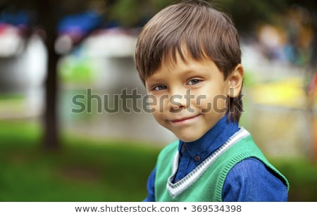 closeup portrait of a little happy boy outside stock photo © zurijeta