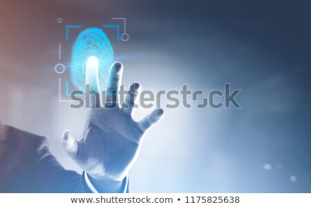 Businessman passing biometric verification with fingerprint scan Stock photo © stevanovicigor