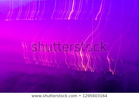 Neon blurry trail effect at motion on dark background, seamless pattern stock photo © Evgeny89