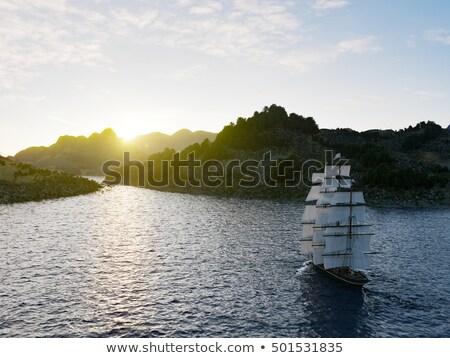 Ship Sailing In Rough Seas Close Up On Sunset Background Stok fotoğraf © denisgo