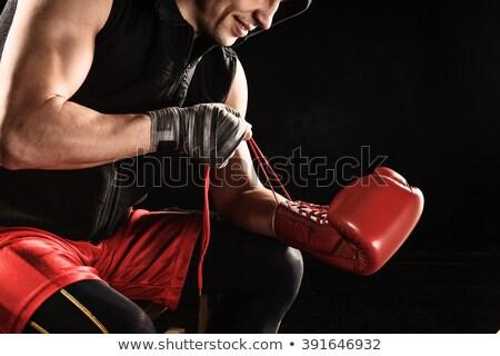 The young  man kickboxing lacing glove Stock photo © master1305