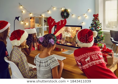 Santa Claus reads Naughty or Nice Kids List Stock photo © vectorikart