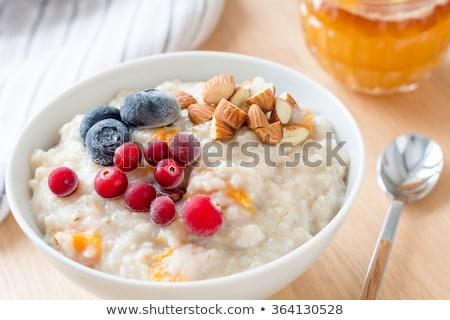 Porridge with cranberries and blueberries Stock photo © luka_prijatelj