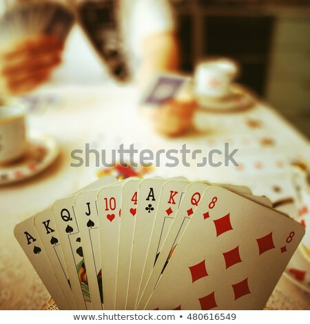 Cup of Coffee and Playing Cards Stock photo © CorelZavr