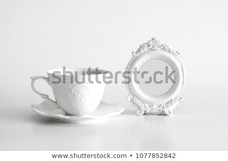 white tea cup with floral decor Stock photo © Digifoodstock