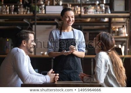 Mosolyog pincérnő ír rendelés jegyzettömb barátok Stock fotó © wavebreak_media