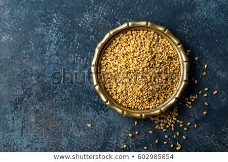 fenugreek seeds on metal plate spice culinary ingredient stock photo © yelenayemchuk