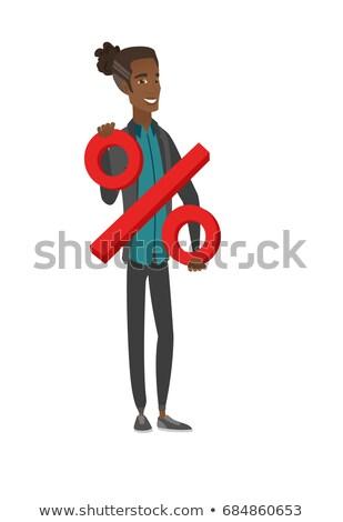 Young african businessman holding percent sign. Stock photo © RAStudio