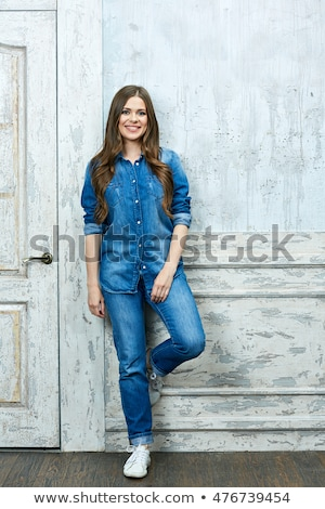 attractive natural woman in jeans posing stock photo © pawelsierakowski