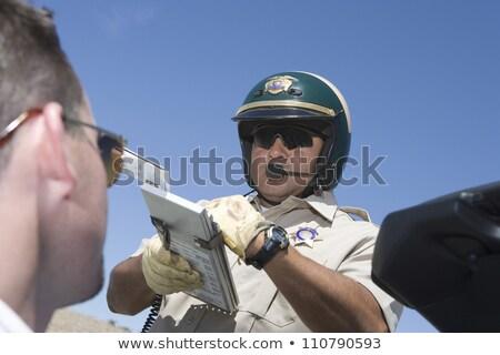 Ruchu policjant piśmie ustawy kierowcy Zdjęcia stock © RAStudio