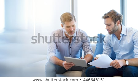 Stock photo: A business man talking to a colleague