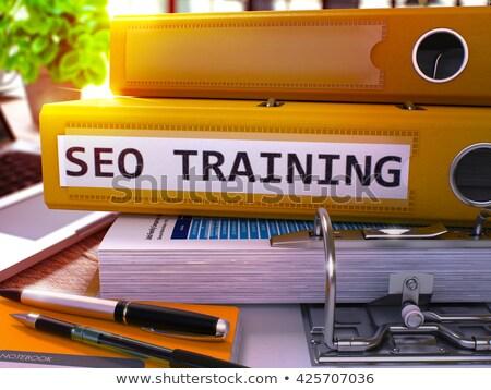 seo training on yellow office folder toned image stock photo © tashatuvango