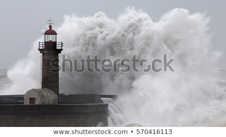 Waves over Lighthouse Stock photo © suerob