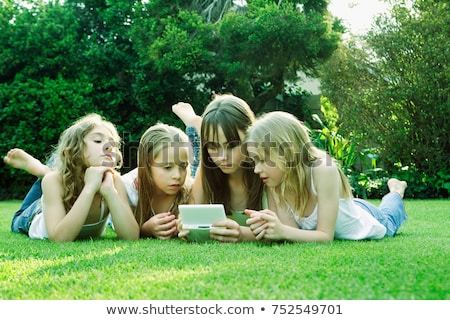 Group of girls playing with Gameboy Stock photo © IS2