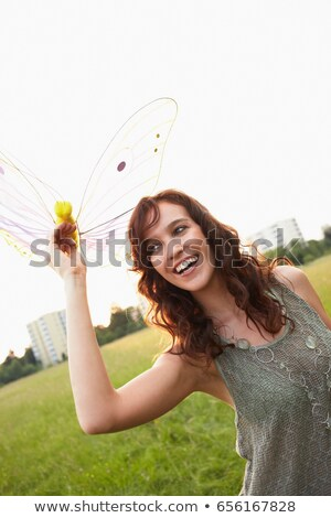 portrait · beauté · brunette · papillon · eau · mains - photo stock © is2