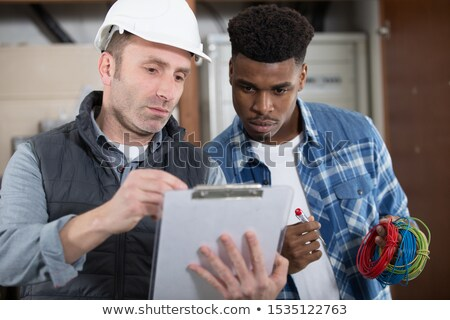 workers talking in warehouse stock photo © is2