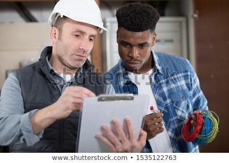 Сток-фото: Workers Talking In Warehouse