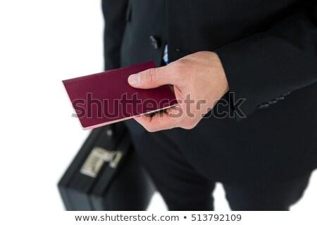 Középső rész üzletember tart aktatáska útlevél fehér Stock fotó © wavebreak_media