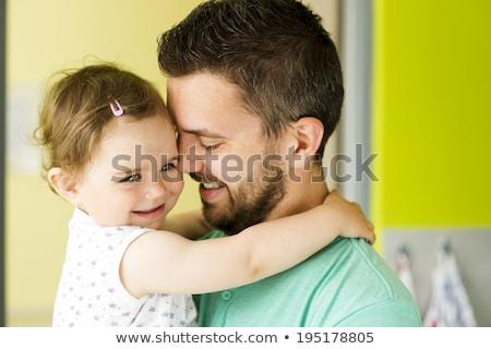 Dad hugging his children Stock photo © bluering