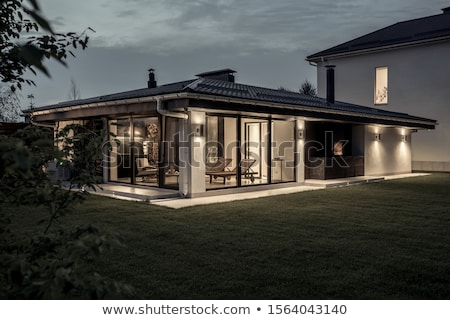 two storey country house with luminous lamps stock photo © bezikus