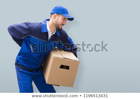 Mover Suffering From Backache While Carrying Parcel Stock photo © AndreyPopov