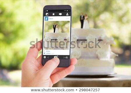 Női kéz tart okostelefon közelkép szobrocska Stock fotó © ruslanshramko