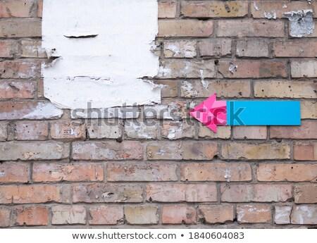 torn blue wallpapers brick wall Stock photo © romvo