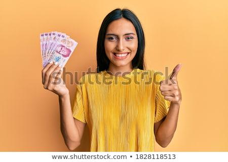 Portrait of a joyful young brunette Stock photo © acidgrey