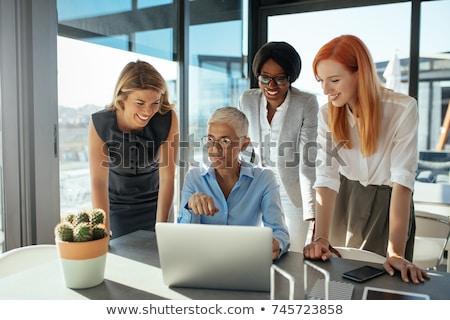 sorridente · colegas · juntos · secretária · escritório - foto stock © minervastock