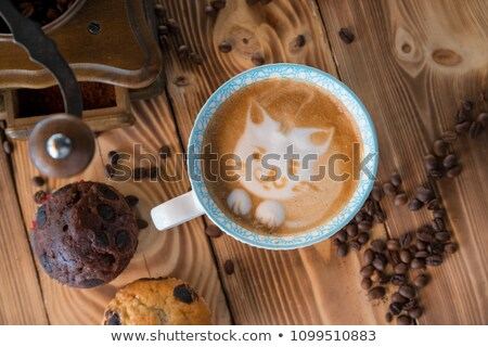 Coffee cup with cat face paint on the table. Stock photo © galitskaya