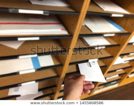 A businessman handing and sending in a envelope letter on a wood Stock photo © snowing