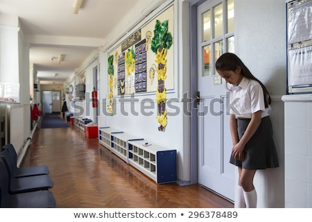Girl being punished by teacher in classroom Stock photo © colematt