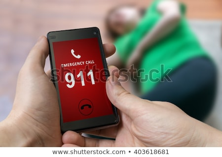 Hand of a man calling the emergency number for an injured woman Stock photo © Kzenon