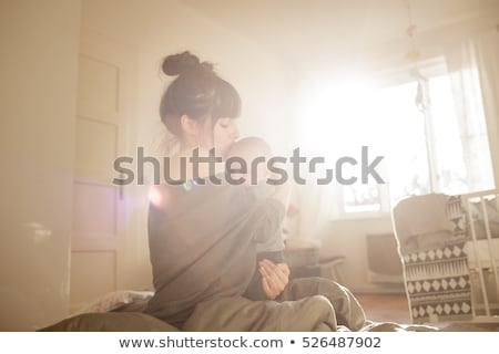 mother with baby on bed having good time stock photo © Lopolo