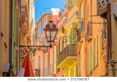 Narrow colorful street of Monaco old town Stock photo © xbrchx