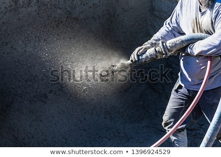 Stok fotoğraf: Pool Construction Worker Shooting Concrete Shotcrete Or Gunite