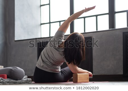 Side bending in gym Stock photo © pressmaster