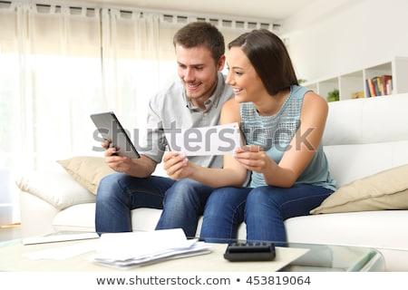 Boldog pár számla mosolyog fiatal pér ül Stock fotó © AndreyPopov