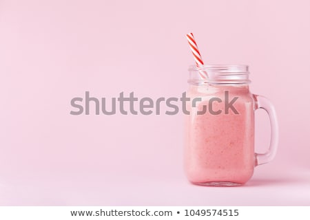 mason jar glass with juice and fruits on table Stock photo © dolgachov