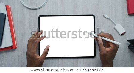 Human Hand Holding Stylus Pen Using Graphic Tablet Stock photo © AndreyPopov