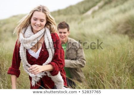 Lopen zand warme kleding strand Stockfoto © monkey_business