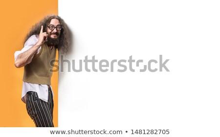 Nerd wskazując pusty pokładzie billboard uśmiech Zdjęcia stock © majdansky