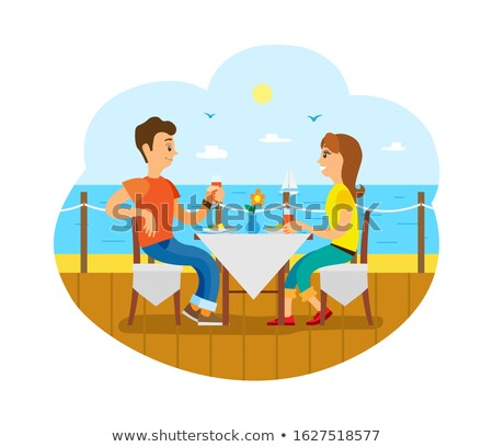 Couple Having Breakfast or Lunch on Deck near Sea Stock photo © robuart