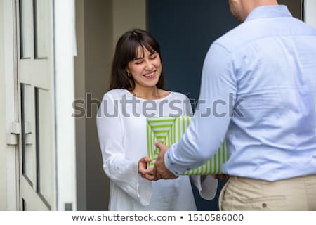 Man Giving Gift Box To His Neighbor Stock photo © AndreyPopov
