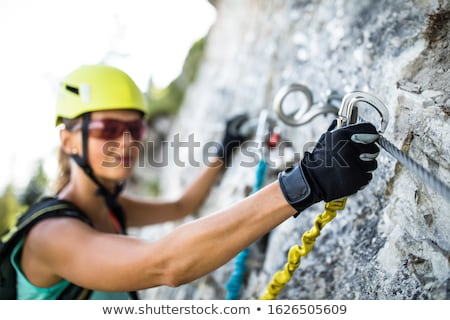 pretty female climber on a via ferrata   climbing on a rock stock photo © lightpoet